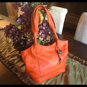 The SAK orange leather hobo